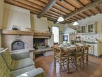 typical tuscan kitchen in the main house with fireplace and wood oven for pizza!