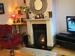 Sitting room with open fire and tv