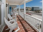 First floor porch with rocking chairs and Gulf view