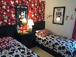 Mickey Mouse Themed room with 2 twin beds and a TV