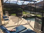 Seating for 10 , a poolside BBQ, Lanai for Shade, and safety gate for kid safety