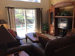 Play on Wii, or relax in our cozy family with TV/DVD with a view of the pool