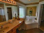 Ensuite Bathroom #1 - Sink, Makeup Bar, Tub, Shower, & private toilet