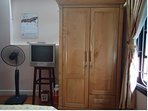 Room 1: Wardrobe, TV and electric fan
