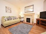 Main front room, gas fire, 42' tv