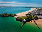 Tenby from the air. Watch the lifeboat launch, play golf or visit Caldey island.