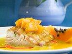 Indulge in freshly caught mahi mahi in coconut papaya chutney