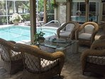 Lounge area in oversized Lanai and Pool