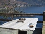 The bbq dining table from a different angle with Andros Island in the background.