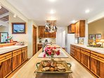 Beautiful Koa wood cabinets and all the kitchen utensils need for a great meal