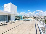 The shared rooftop terrace with pool, sundeck and lounge area - Amazing City and Ocean Views