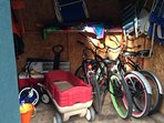 Our shed with chairs, beach toys and bikes