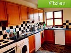 Fully equipped kitchen with cooking utensils and appliances