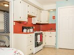 Full kitchen with dinnerware, glassware, utensils,pots, pans, kettle, coffee pot, microwave, etc.