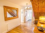 Bright and spacious Hall. Smoked oak wood floor. Beautiful hand-crafted stairway.