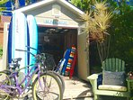 Your Beach Stuff Shed w/ Bicycles, surfboards, Boogie Boards, Beach Chairs, Coolers, and Umbrellas.