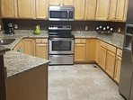 Large kitchen will all stainless steel appliances