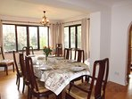 Very large dining area has large windows to take advantage of garden view