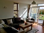 Lounge with Large Patio Doors Leading onto Private Decked Area