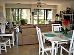SPACIOUS DINING, LIVING ROOM, AND SCREENED PORCH