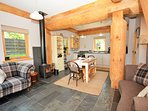 Spacious open plan living room/kitchen with wood burning stove.
