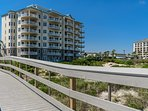 Enjoy the breeze on the ocean front balcony. Short boardwalk from pool to beach.