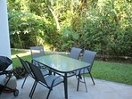 Secluded rear terrace with gas grill.  Only trees and plants are between the garden and golf course