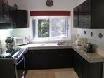 Fully equipped kitchen with granite worktops, refurbished in 2016 with new stove etc. Views of pool