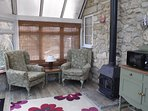 Comfortable sitting area in the Conservatory with wood burner.