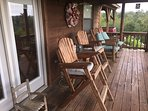 Locally crafted rocking chairs, and tall director chairs on back covered deck