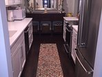 Newly renovated kitchen with stainless steel Kitchenaid appliances.