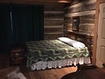 The king bed half of the big master bedroom at Cave Creek Cabin.
