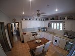 Kitchen with full size oven and hob, washing machine, fridge, beer fridge, freezer. all you need.