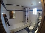 Main bathroom with full size bath and shower.