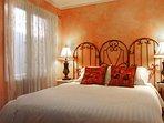 Bedroom with queen bed and walk-in closet
