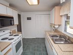 Fully stocked modern kitchen with laundry. Full size washer and dryer.