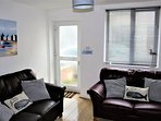 Front Room, flat screen Tv, Freesat, DVD player, 2 comft leather sofas, mirror, nest of tables