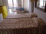 Salón con 2 camas