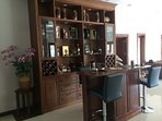 Full bar inside home. Comfortable place to sit and socialize or have a night cap.