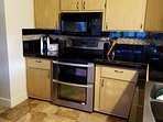 Kitchen had plenty of counter space to prepare food. Upgraded granite counters. New double oven.
