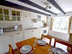 The smart fitted kitchen/diner includes a dishwasher, washing machine and freezer.