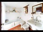 Bathroom 3 (with tub, en-suite to bedroom 4)