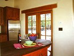 Kitchen serving bar, stainless fridge, French door walk out to wilderness