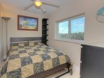 Guest bedroom with queen size bed showcases views of the Intracoastal in Flagler