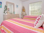 Guest bedroom is complete with two twin beds and views of the Intracoastal