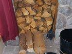 Firewood storage inside next to fireplace
