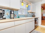 Stunning tile kitchen makes it easy to prepare a coastal meal at Beach Cottage