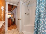 Spacious guest bathroom offers plenty of storage and a walk in shower