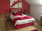 Red room - double bed with walk in wardrobe and shower en suite