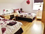 Twin room with shower en suite - cot and extra mattress to throw down for kids available on request